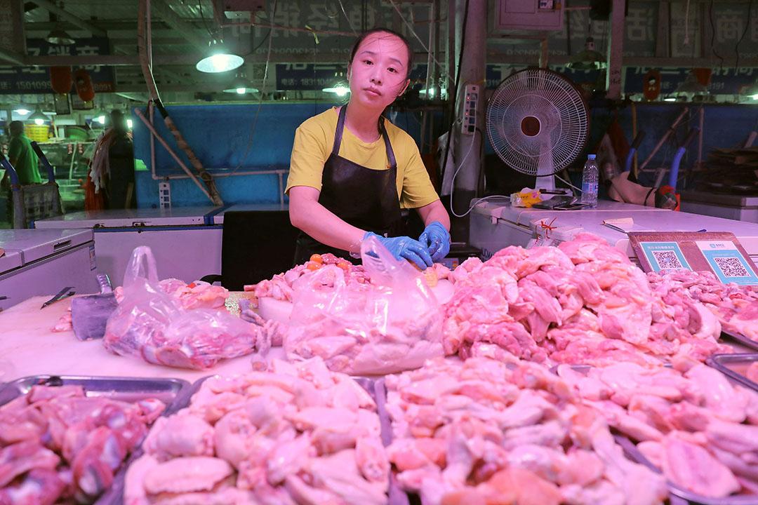 Verkoop van kippenvlees in China. - Foto: ANP - Foto: ANP