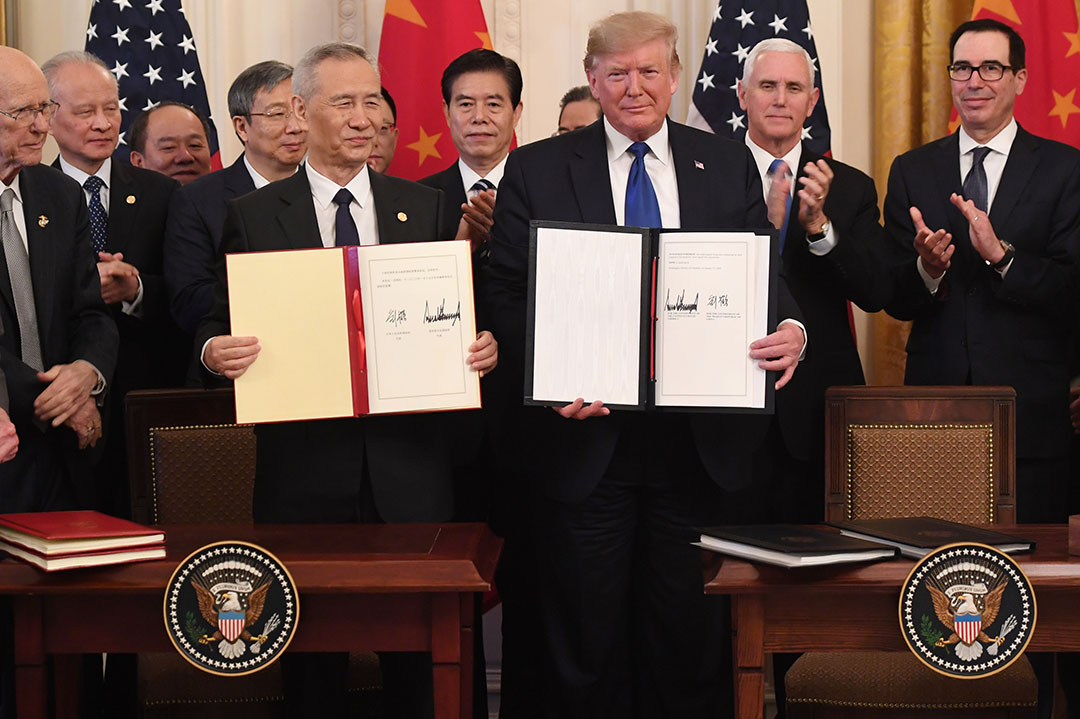 Ondertekening van de handelsdeal in Washington op 15 januari. - Foto: ANP