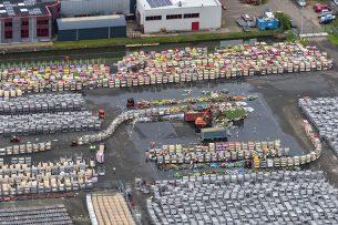 Luchtfoto van bloemen die worden doorgedraaid op de bloemenveiling Aalmeer. De Nederlandse sierteeltsector luidde de noodklok over de effecten van de coronacrisis. - Foto: ANP