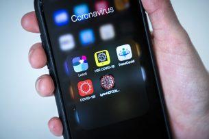 Een aantal corona-apps op een telefoon. Foto: ANP
