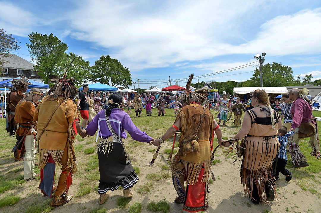 Native Americans of different tribes take part in a circle/friendship dance during the 29th Annual Spring Planting Moon Pow Wow run by the Massachusetts Center for Native American Awareness at the Marshfield Fair Grounds in Marshfield, Massachusetts, May 25, 2019.
