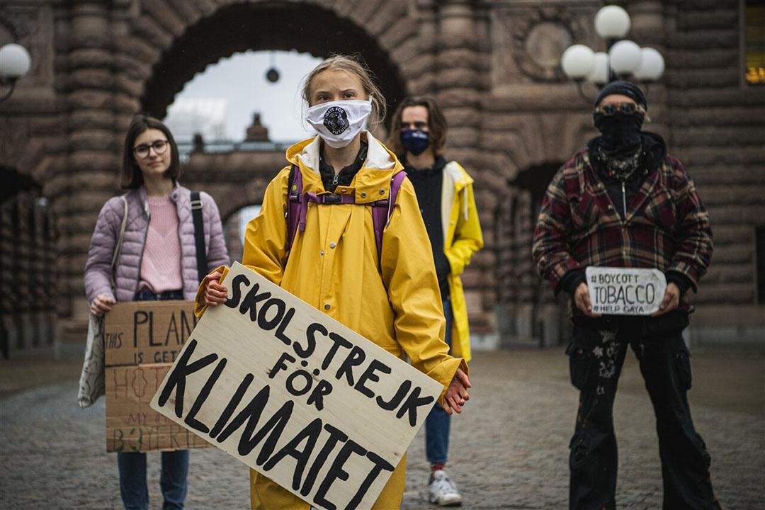 Greta Thunberg (midden) en haar medestanders betogen dat landbouw vervuilt en bijdraagt aan een verlies van biodiversiteit. - Foto: AFP/Jonathan Nackstrand