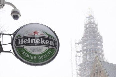 Om de coronacrisis het hoofd te bieden, maar ook om de winstgevendheid structureel te verbeteren wordt een forse reorganisatie bij Heineken doorgevoerd. Foto: ANP