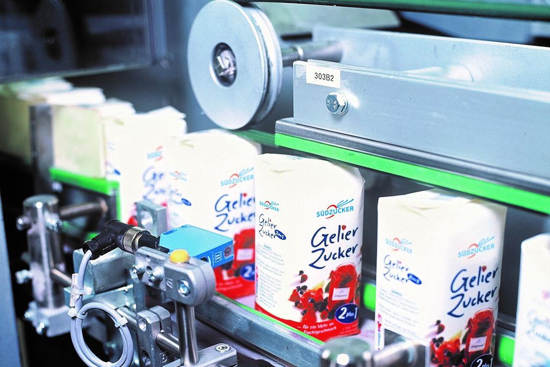 Verpakken van suiker in productielocatie van Südzucker. De koers van de grootste suikerproducent in Europa stijgt door de hoge suikerprijs. - Foto: Südzucker