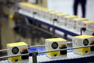 Productie van koffiecapsules in de Nestlé-fabriek in Schwerin, Duitsland. - Foto: ANP